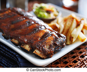 bbq ribs with cole slaw and french fries, close up