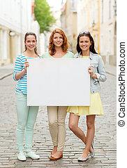 smiling teenage girls with blank billboard - vacation,...
