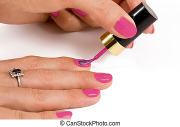 Applying nail varnish - Close up of woman applying nail...