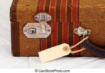 Vintage Suitcase with Blank Tag - Vintage suitcase with a...