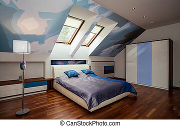 Interior of blue and white bedroom in the attic