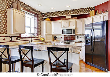 Kitchen room interior. View of counter top with black chairs...