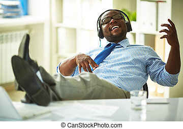 Music delight - Image of young businessman taking pleasure...