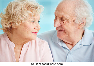 Happy senior life - Senior couple exchanging affectionate...