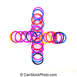 Colorful rubber band plus symbol.
