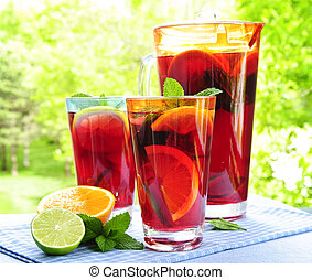 Fruit punch in pitcher and glasses - Refreshing fruit punch...