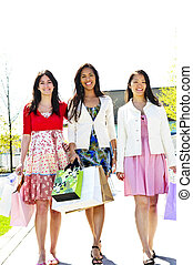 Young girlfriends shopping - Three young girl friends...