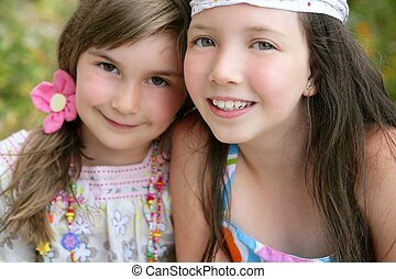 closeup portrait of two little girl sisters - closeup...