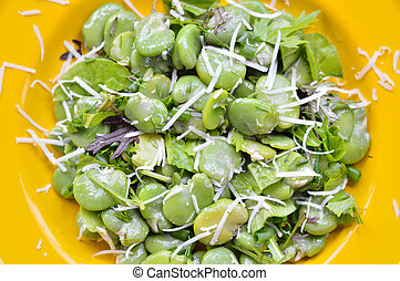 Close-up of broad bean salad with hard cheese - Close-up of...