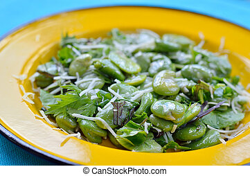 Close-up of broad bean salad with h - Close-up of green...