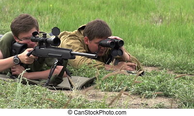Sniper Makes the Shot - Sniper rifle with optical lying...