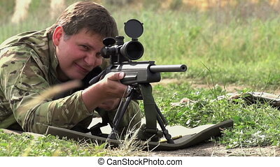Sniper Shot - Sniper rifle shot does in the supine position....