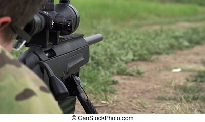 Sniper Shoots from a Rifle - Sniper rifle shot does in the...