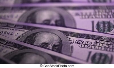 One hundred dollars banknotes macro. Rotation.
