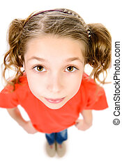 big eyes - Portrait of a pretty ten years girl looking up at...
