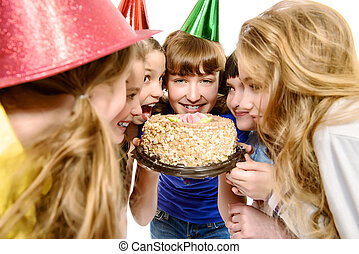 appetite - Group of happy kids celebrating birthday with a...