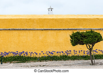 Fort of Peniche (Portugal) - Yellow wall of the prison in...