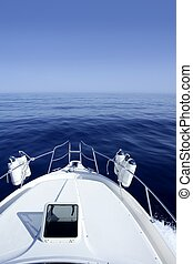 Boat on the blue Mediterranean Sea yachting on a calm ocean
