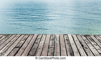 Wooden pier with sea. - Wood terrace on the beach.