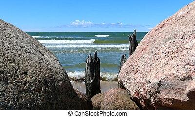 Sea view through stones