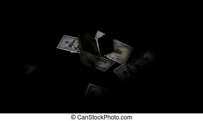 Falling one hundred dollars pile as black background.