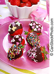 chocolate covered fresh strawberries with colorful sprinkles...