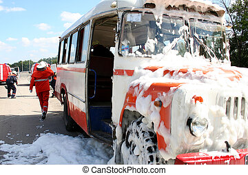 firefighters extinguish a burning bus - firefighters in gas...