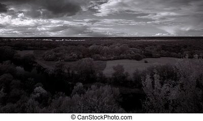 InfraRed landscape: Movement of clouds over the river...