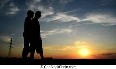 Lovers on a date in sunset, holding hands. Romantic love...