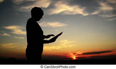 Woman using digital tablet computer