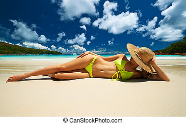 Woman at beach - Woman in bikini at tropical beach at...