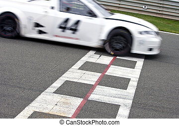 Race Track Finishline - Race car crossing the finish line on...