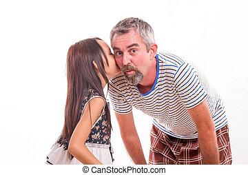 Daughter whispering secret in dad's ear - Daughter telling...
