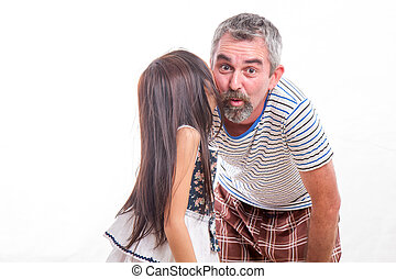 Girl whispering in dads ear - Daughter telling dad a secret,...