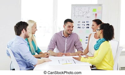 team with hands on top of each other in office - business,...