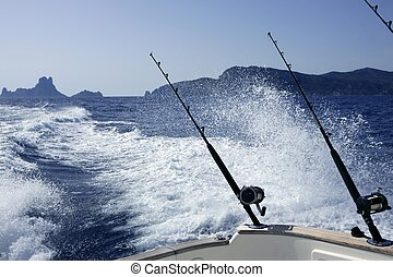 Fishing rod and reel on boat blue ocean - Fishing rod and...