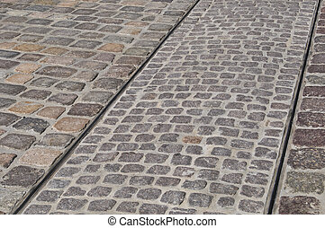 Tracks - tracks of a tram on a cobblestone pavement