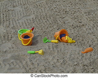 Sandbox - colorful toys lying scattered in a sandbox