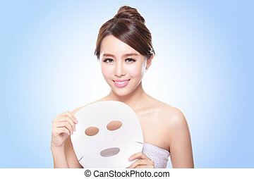 happy Young woman with cloth facial mask isolated on blue...