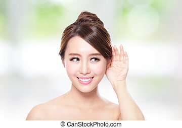Young Beauty woman listen by ear with health skin and teeth,...