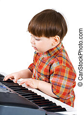 young toddler stu to play music on piano