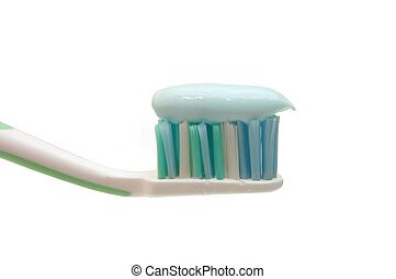 Close-up of a toothbrush with paste isolated on white background