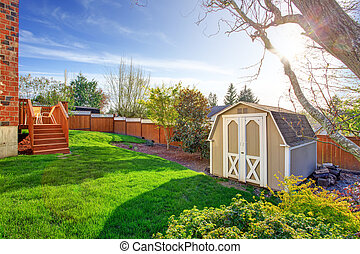 Fenced backyard with small shed - Fenced backyard with...