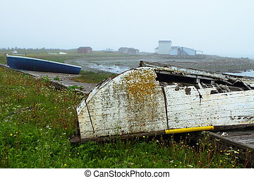 Rustic boat - Old ruined boat on the shore in misty weather