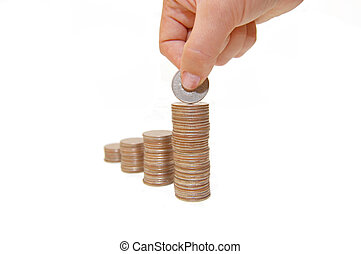 Increase your savings-Hand holding coins against white background