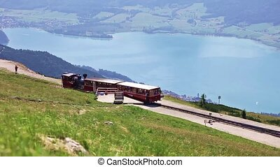 Diesel train railway carriage going - ST WOLFGANG, AUSTRIA -...