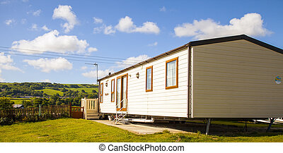 Static caravan holiday homes at a U. K. holiday resort.