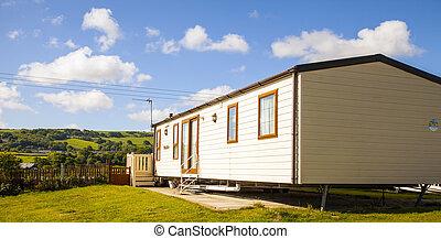 Static caravan holiday homes at a U. K. holiday resort.