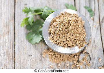 Cilantro Powder - Portion of brown Cilantro Powder (close-up...