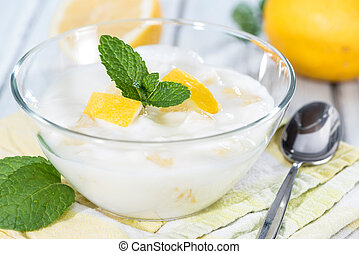 Homemade Lemon Yoghurt decorated with fresh Mint